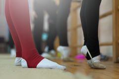 Close up of feet of young gymnast stretching stock photography