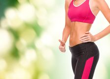 Close up of female abs and hand showing thumbs up Stock Photography