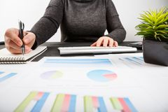 Close up of female accountant or banker making calculations. Savings, finances and economy concept Royalty Free Stock Photography