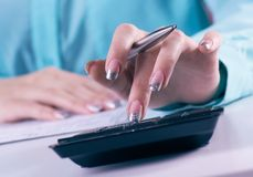 Close up of female accountant or banker making calculations. Savings, finances and economy concept. Close up of female accountant or banker making calculations royalty free stock photo