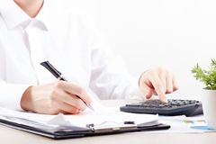 Close up of female accountant or banker making calculations. Savings, finances and economy concept.  Stock Images