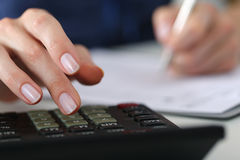 Close up of female accountant or banker making calculations Stock Images