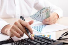 Close up of female accountant or banker making calculations. Savings, finances and economy concept.  Stock Image