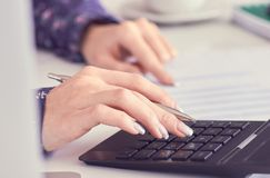 Close up of female accountant or banker hand making calculations. Savings, finances and economy concept. Close up of female accountant or banker making royalty free stock image