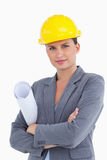 Close up of female architect with helmet and plans Royalty Free Stock Photo