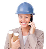 Close-up of a female architect on phone Stock Image