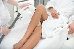 Girl hand having hair removal with gadget royalty free stock photos