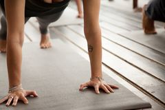 Close up of female arms in Plank pose stock photography