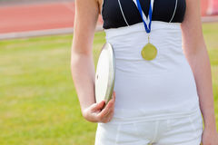 Close-up of a female athlete holding a disc stock images