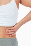Close up of female with back pain Stock Image