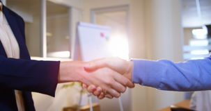 Close-up of female business executives shaking hands. In office 4k stock footage
