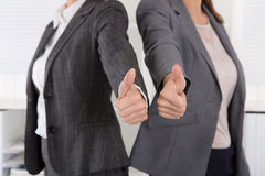 Close-up of female business team holding their thumbs up Royalty Free Stock Photography