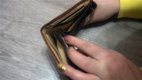 Close up of female businessman`s hands showing empty wallet. Concept of personal or business bankruptcy, financial Stock Photo