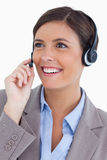Close up of female call center agent with headset. Against a white background Stock Image
