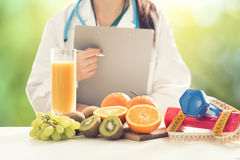 Close up of a Female Dietician. With Fresh Vegetables and fruits royalty free stock photos