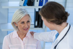 Close-up of female doctor consoling a patient Stock Images