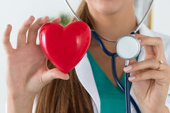 Close-up of female doctor hands holding read heart and stethoscope. Head. Healthcare and medical concept royalty free stock image