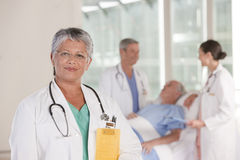 Close up of female doctor smiling Stock Photos