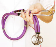 Close-up of female doctor using stethoscope Royalty Free Stock Image
