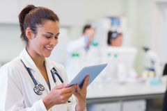 Close up of a female doctor using tablet PC Royalty Free Stock Image