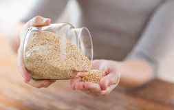 Close up of female emptying jar with quinoa Stock Images