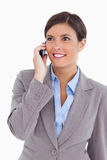 Close up of female entrepreneur on her cellphone. Against a white background Stock Image