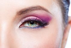 Close up of female eye with bright pink makeup Stock Photos