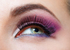 Close up of female eye with brilliant pink makeup Stock Photo