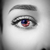Close-up female eye with country flag Stock Images