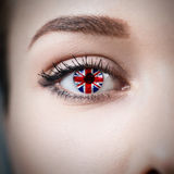 Close-up female eye with country flag Royalty Free Stock Images