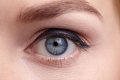 Close-up of female eye. Make-up arrow. Stock Photos