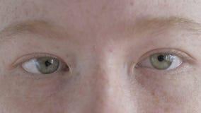 Close up of female eyes blinking stock video