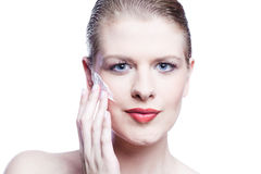 Close up of female face applying face cream Royalty Free Stock Photography