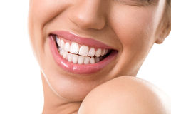 Close up  of female face with a clean white teeth Royalty Free Stock Photography