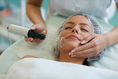 Close up of female face during cosmetic treatment Stock Images