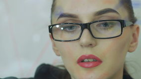Close up of female face looking at the screen of digital tablet stock video footage