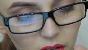 Close up of female face looking at the screen of digital tablet stock video