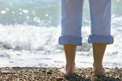 Close up of female feet on beach. Close up of female feet on pebble beach Stock Photography