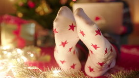Close up of female feet in christmas socks dancing on Christmas eve stock footage
