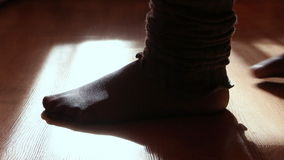 Close up of a female feet doing exercises indoors stock video footage
