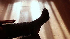 Close up of a female feet doing exercises indoors stock footage