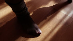 Close up of a female feet doing exercises indoors Stock Image
