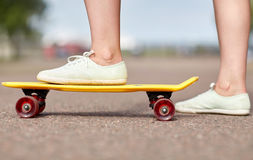 Close up of female feet riding short skateboard Stock Photo