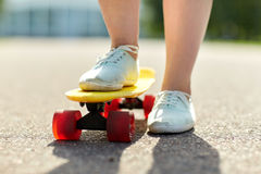 Close up of female feet riding short skateboard Stock Image