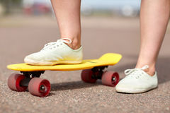 Close up of female feet riding short skateboard Royalty Free Stock Photography