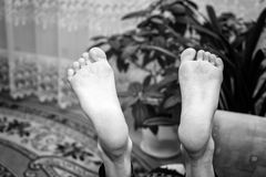 Close up of female feet sleeping. On the couch Royalty Free Stock Photography