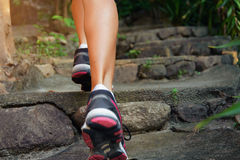 Close-up of female feet in sneakers walking. Outdoors Stock Photography