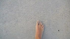 Close up of female feet on white sandy beach. Closeup of female feet on white sandy beach stock video