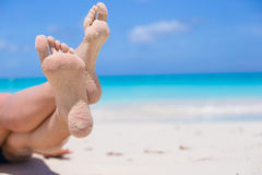 Close up of female feet on white sandy beach Royalty Free Stock Images