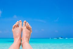 Close up of female feet on white sandy beach. Close up of female feet on white sand beach Stock Images